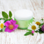 container with cream and wild flowers stock photo © es75
