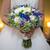 kék · lila · virágcsokor · nő · virágok · kéz - stock fotó © esatphotography
