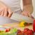 human hands cooking vegetables salad in kitchen stock photo © evgenyatamanenko