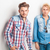 two young fashion men standing against studio wall stock photo © feedough