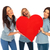 three laughing casual women holding a big red heart stock photo © feedough