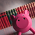 pink piggy bank looking happy in front of book stock photo © feedough