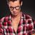 man wearing glasses looking down stock photo © feedough