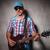 boldog · férfi · gitáros · áll · játszik · elektromos · gitár - stock fotó © feedough