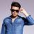 man holding his fashionable sunglasses stock photo © feedough