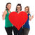 women holding a big heart and make the ok sign stock photo © feedough