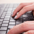 hands of business woman typing on laptop keyboard stock photo © feelphotoart