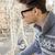 meglepődött · férfi · szemüveg · csésze · kávé · kéz - stock fotó © feelphotoart