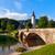 church of sv john the baptist and a bridge by the bohinj lake stock photo © fesus