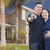 Hispanic Couple with House Keys In Front of New Home stock photo © feverpitch
