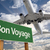 Bon Voyage Green Road Sign and Airplane Above stock photo © feverpitch