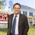 real estate agent in front of for sale sign house stock photo © feverpitch