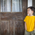 Melancholy Mixed Race Boy Standing In Front of Door stock photo © feverpitch
