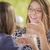 aantrekkelijk · halfbloed · vriendinnen · praten · dranken · buiten - stockfoto © feverpitch