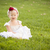 Adorable Little Girl Wearing White Dress In A Grass Field stock photo © feverpitch