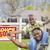 vader · zoon · onroerend · teken · home · gelukkig · afro-amerikaanse - stockfoto © feverpitch
