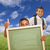 hispanic students with thumbs up in grass field holding blank chalk board stock photo © feverpitch