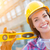 portrait of young female construction worker with level wearing stock photo © feverpitch