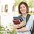 glimlachend · jonge · vrouwelijke · student · buiten · boeken - stockfoto © feverpitch