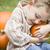 cute young child boy enjoying the pumpkin patch stock photo © feverpitch