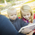 anya · gyerekek · olvas · mesekönyv · ágy · ház - stock fotó © feverpitch