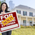 female holding sold by owner sign in front of house stock photo © feverpitch