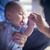 cute · halfbloed · zuigeling · jongen · duim · moeder - stockfoto © feverpitch
