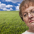 Melancholy Senior Woman with Grass Field Behind stock photo © feverpitch