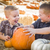 two boys at the pumpkin patch talking and having fun stock photo © feverpitch
