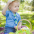 Cute Little Boy Outside Holding Easter Eggs Tips His Hat stock photo © feverpitch