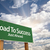 road to success green road sign over clouds stock photo © feverpitch