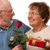 happy senior couple with gift and red rose stock photo © feverpitch
