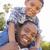 halfbloed · vader · zoon · spelen · op · de · rug · gelukkig · park - stockfoto © feverpitch