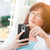 attractive middle aged woman using her smart phone stock photo © feverpitch