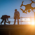 silhouette of unmanned aircraft system uav quadcopter drone in stock photo © feverpitch