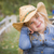 cute young girl wearing cowboy hat posing for portrait outside stock photo © feverpitch