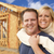 couple in front of new home construction framing site stock photo © feverpitch