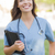 young adult woman doctor or nurse holding touch pad outside stock photo © feverpitch