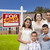 hispanic family new home and sold real estate sign stock photo © feverpitch