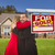 mixed race couple house sold real estate sign stock photo © feverpitch