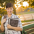 portrait of a pretty mixed race female student holding books stock photo © feverpitch