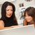 hispanic mother and mixed race daughter on the laptop stock photo © feverpitch