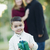 Mixed Race Boy Holding Gift In Front with Parents Behind stock photo © feverpitch