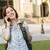 Young Female Student Walking Outside Using Cell Phone stock photo © feverpitch