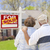 senior couple in front of sold real estate sign and house stock photo © feverpitch