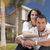 Happy Hispanic Young Couple in Front of Their New Home stock photo © feverpitch