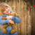 girl holding teddy bear in front of wooded background with chris stock photo © feverpitch