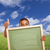 boy with thumbs up in field holding blank chalk board stock photo © feverpitch
