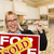 young woman holding sold sign and keys inside new kitchen stock photo © feverpitch
