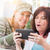 two female friends laugh while using a smart phone stock photo © feverpitch
